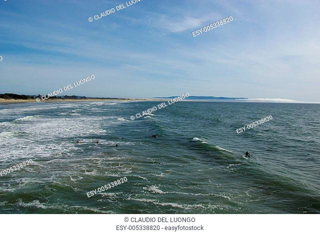 Beach,dunes and surfers on Pacific Coast, Pismo Beach, California