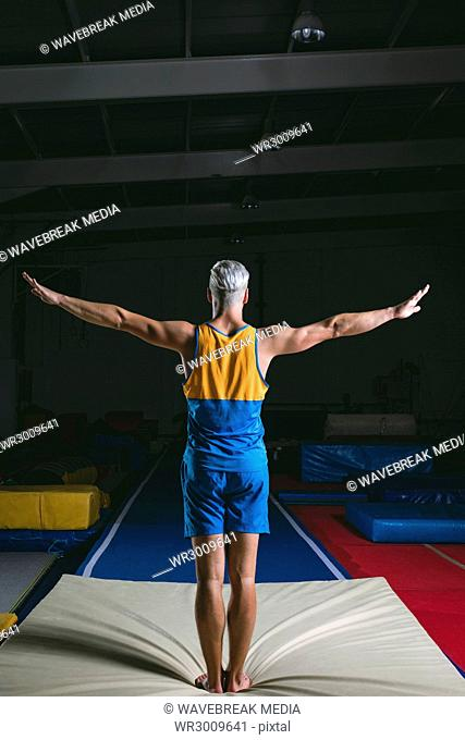 Male gymnast ready to perform gymnastic exercise