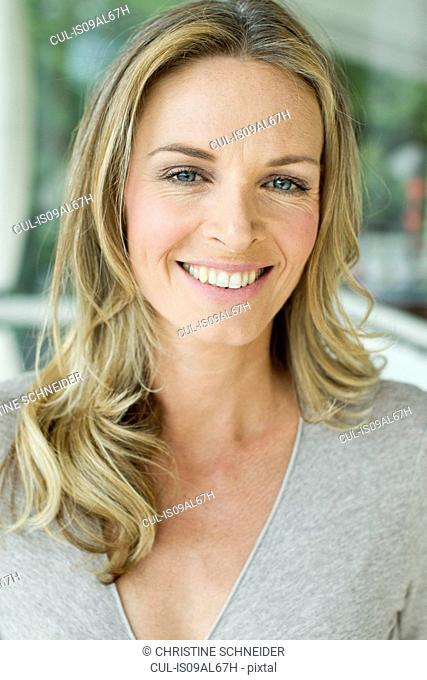 Mature blonde woman, close up portrait