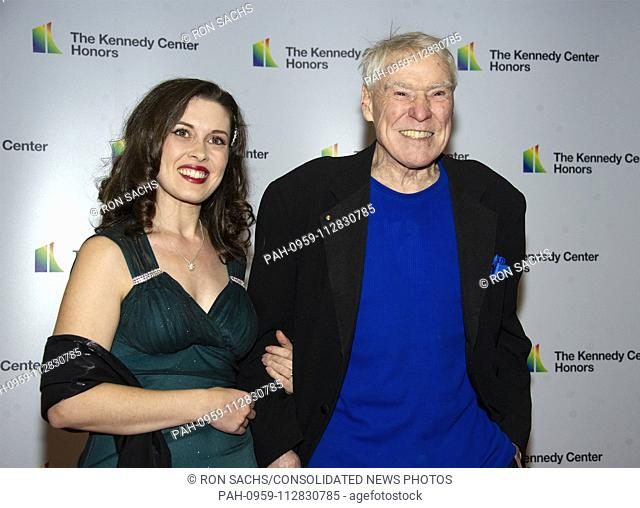 Jacques d'Amboise, right, and Emily Reid arrive for the formal Artist's Dinner honoring the recipients of the 41st Annual Kennedy Center Honors hosted by United...