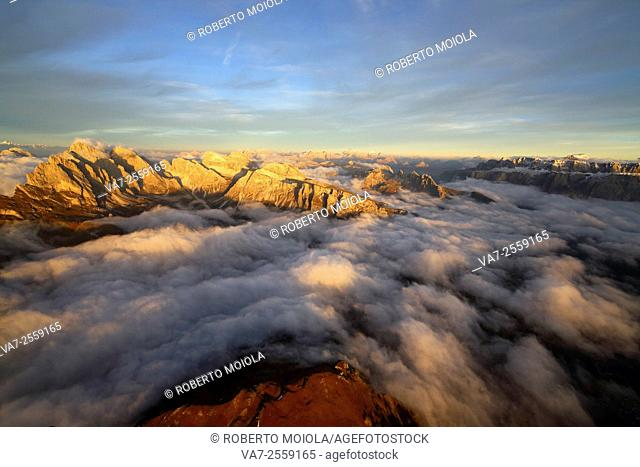 Aerial shot from Seceda of Odle surrounded by clouds at sunset. Dolomites Val Funes Trentino Alto Adige South Tyrol Italy Europe
