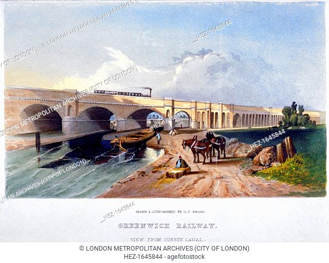 Greenwich Railway, Deptford, London, 1836. View from the Surrey Canal showing the towpath, barges and horses and a steam train on the viaduct