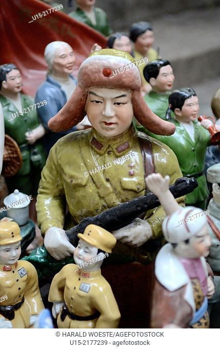Hong Kong, China, Asia. Propaganda toy figures displayed in shop window