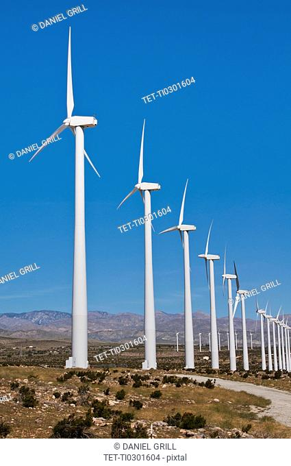 USA, California, Palm Springs, Wind turbines against blue sky