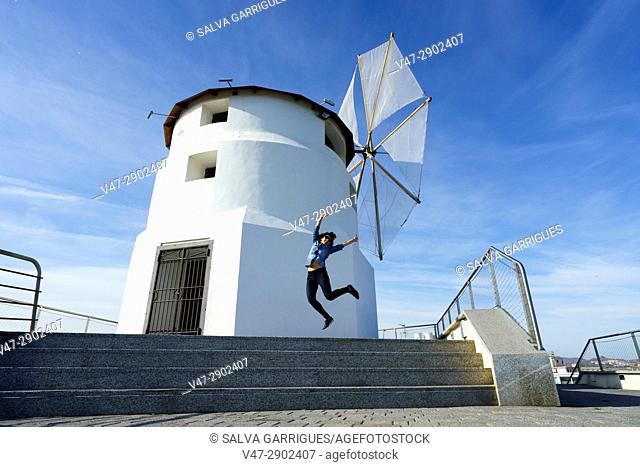 Woman jumping of joy in the Mill of Sagrera, Aguilas, Murcia, Spain
