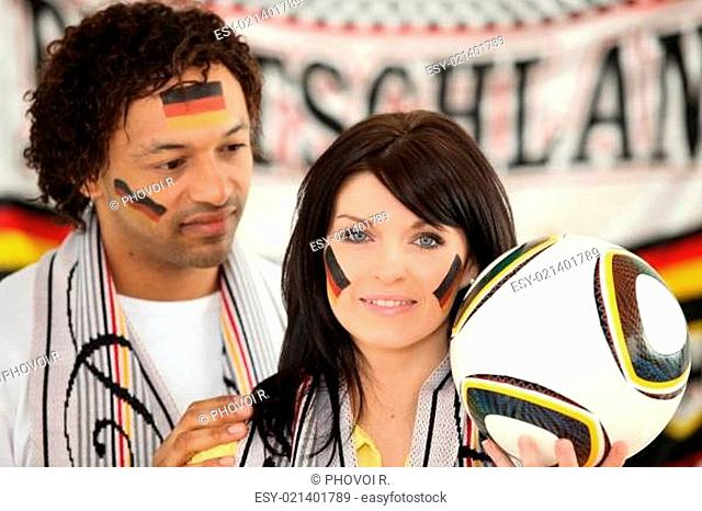 German couple supporting their soccer team