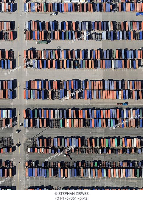 Aerial view trains in sunny shunting yard, Los Angeles, California, USA