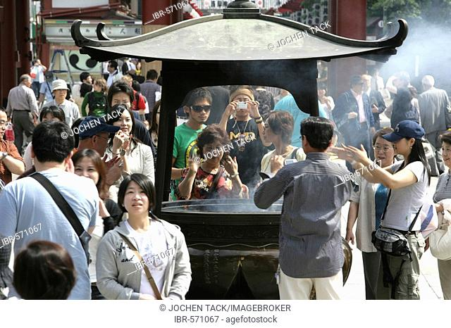 Japan, Tokyo: Shrine festival, called Matsuri. Asakusa Kannon Shrine Temple district. incense fountain