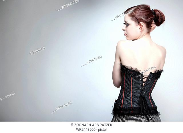 Young woman in vintage outfit