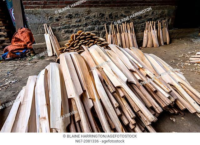 Carving cricket bats by hand at Astro Bat Factory, Kashmir, Jammu and Kashmir State; India