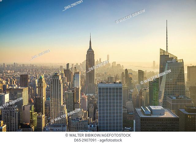 USA, New York, New York City, Mid-Town Manhattan, elevated view of The Empire State Building, sunset