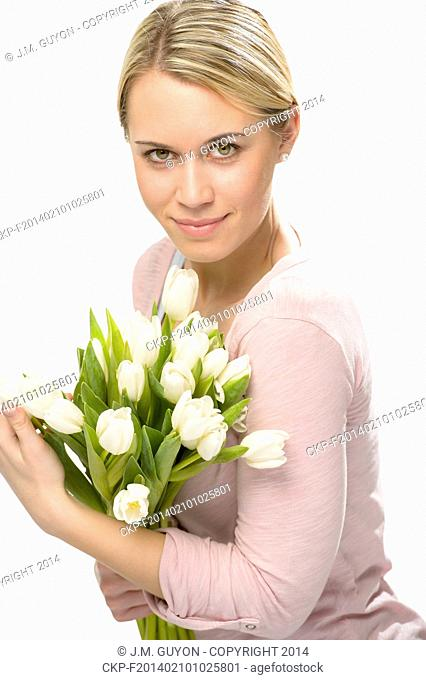 Romantic woman hold bouquet of white tulip flowers isolated