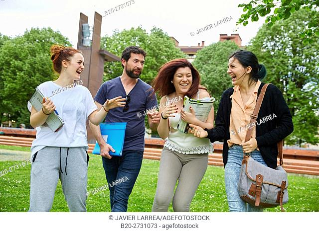 Students walking on campus lawn