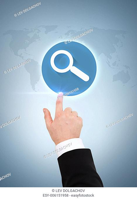 business and advertisement concept - close up of businessman pointing to magnifying glass