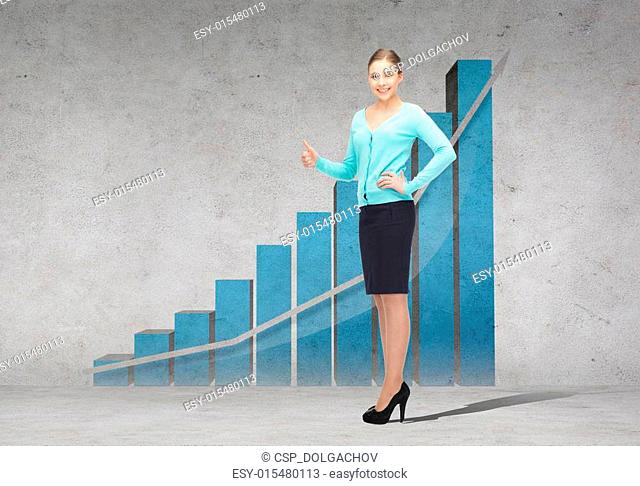 smiling businesswoman showing thumbs up