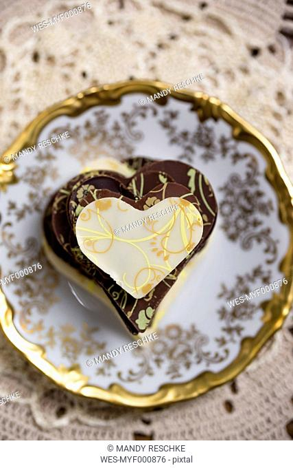 Stack of homemade chocolate hearts on plate