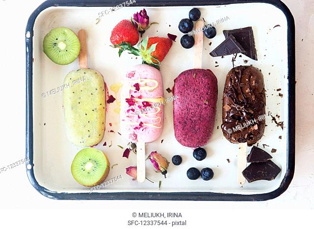 Kiwi, strawberry, blueberry and chocolate popsicles