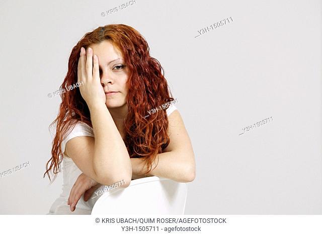 Studio shot of woman, looking at camera