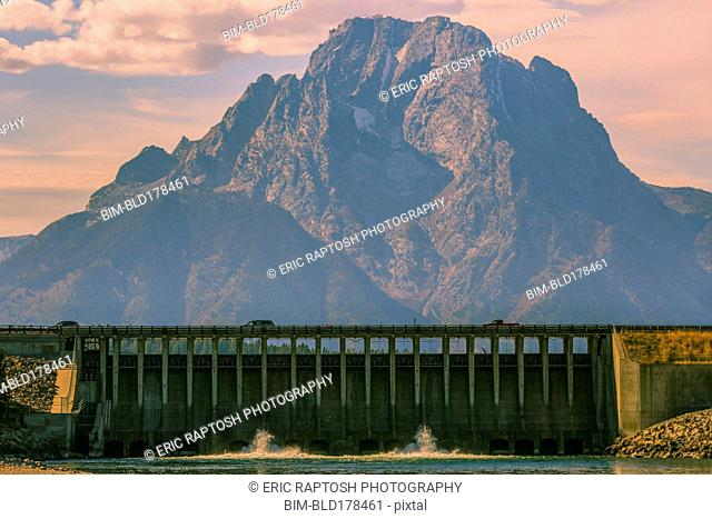 Mountain and dam in remote landscape