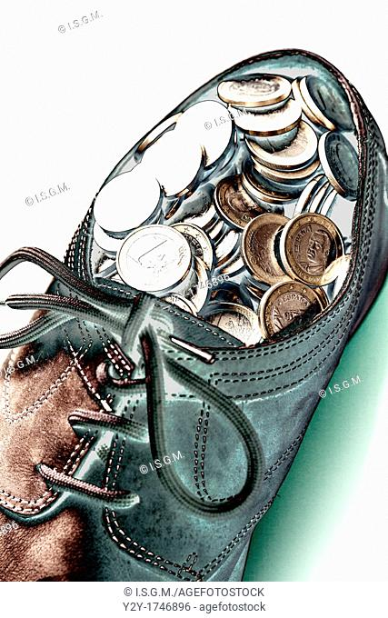Shoe with coins