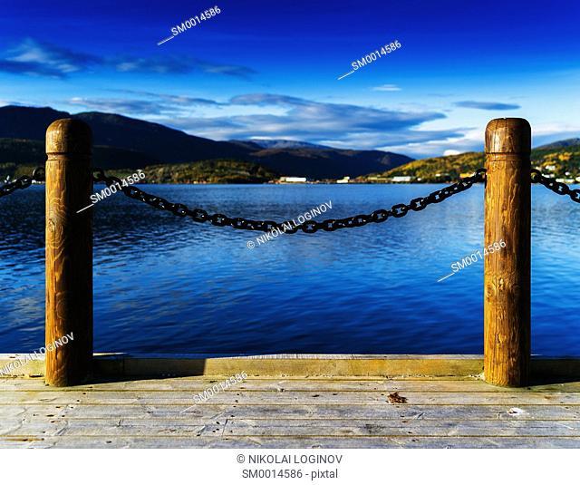 Horizontal vivid Norway fjord ocean landscape pier composition background backdrop