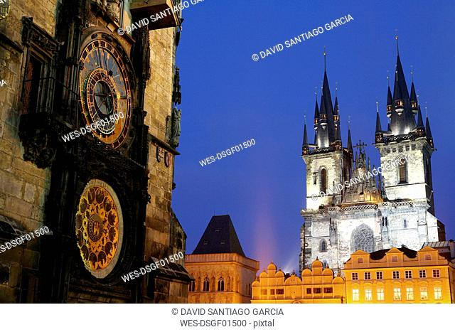 Czechia, Prague, part of Town Hall with Astronomic Clock and Church of Our Lady Before Tyn at dusk