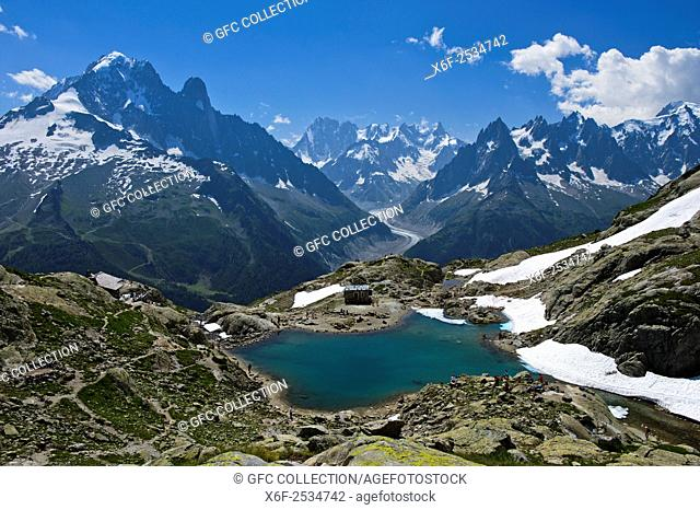 View across the mountain lake Lac Blanc in the Aiguilles Rouges National Nature Reserve to the French Alps, f. l. t. r. Aiguille Verte, Les Drus