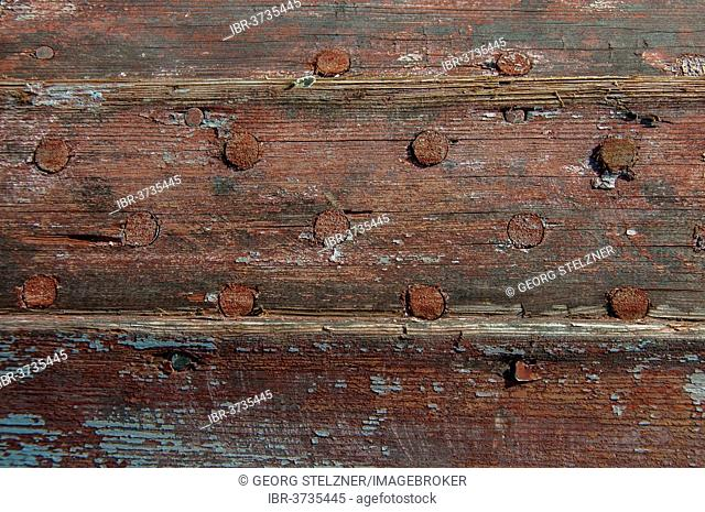 Weathered planks of a boat with residues of red paint, Jutland, Denmark