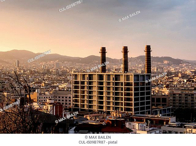 Elevated cityscape view with row of smokestacks, Barcelona, Spain