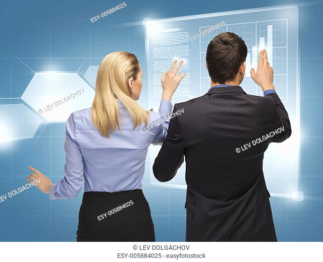 picture of man and woman working with virtual screens