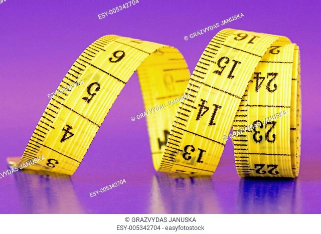 close-up of a yellow measure tape