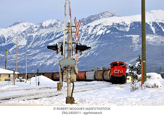 A Canadian National freight train traveling through the town of Jasper in Jasper National Park Alberta Canada
