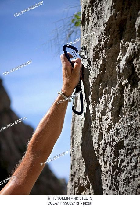 Rock climber securing himself