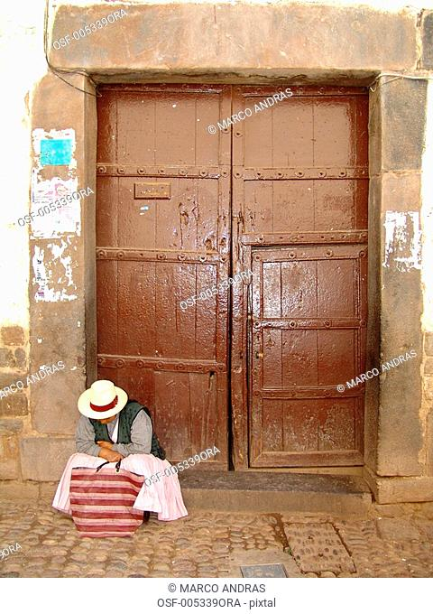 peru one person sleeping in front of a door
