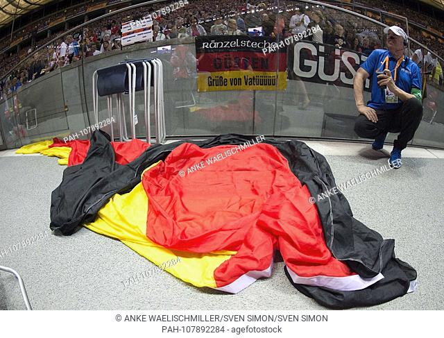 Feature, a very big Germany flag holletted lies on the ground. Final discus throwing women, on 11.08.2018 European Athletics Championships 2018 in Berlin /...