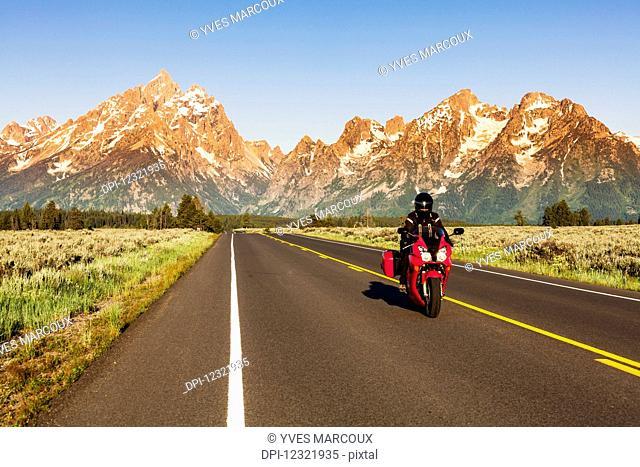 Teton Park Road and Teton Range at sunrise, Grand Teton National Park; Moose, Wyoming, United
