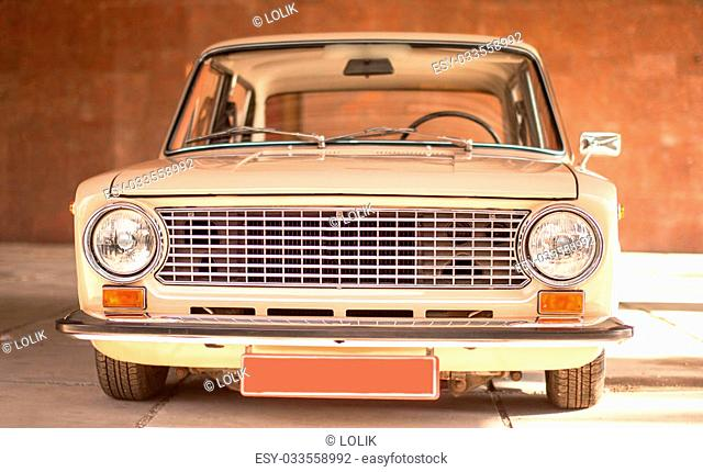 Beige old russian restored car, front view