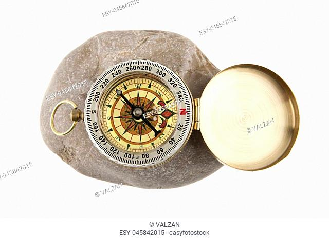 compass on a stone isolated a white background