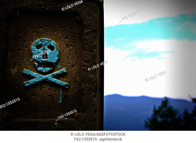 Skull and crossbones symbol on power pole