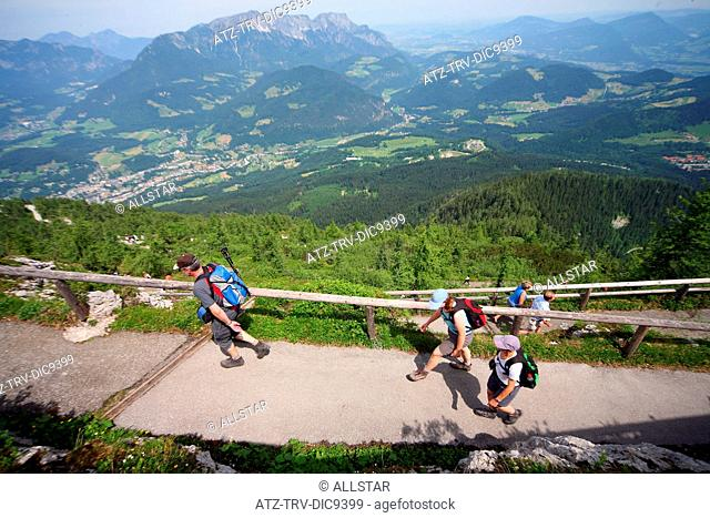WALKERS ON FOOTPATH TO EAGLES NEST, KEHLSTEINHAUS WITH UNTERSBERG MOUNTAIN BEHIND; NEAR BERCHTESGADEN, GERMANY; 24/06/2008