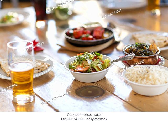 salad with other food on indian restaurant table