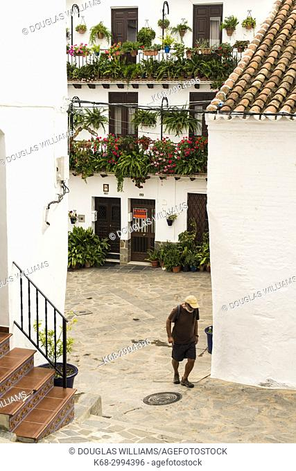 A man walks in the street in Canillas de Albaida, Malaga province, Spain