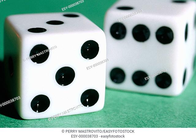 White dices on green background