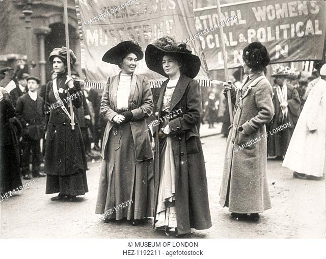 Christabel Pankhurst at a suffragette demonstration, c1910. Behind is a banner for the Women's Social and Political Union