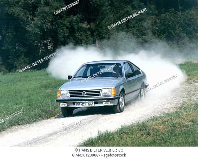 Car, Opel Monza 3.0 S, model year 1978-1981, old car, 1970s, seventies, 1980s, eighties, driving, diagonal front, front view, road, country road, Staub