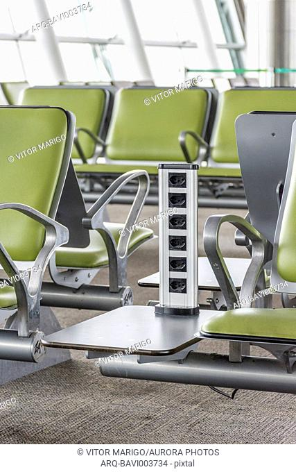 Row of electrical outlets between empty chairs in Brasilia International Airport, Brasilia, Distrito Federal, Brazil