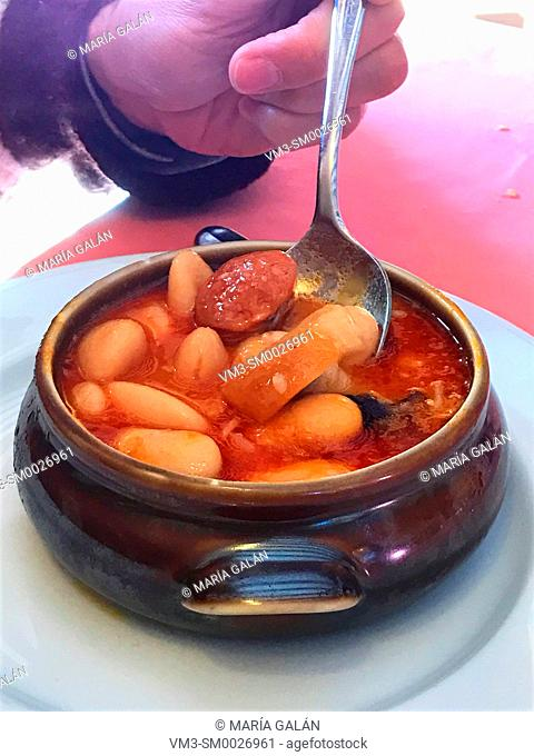 Eating beans stew. Spain