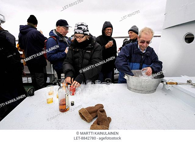 A boat trip to ice glacier in Spitsbergen, Svalbard. The captain offered over 2000 year old glacier ice with whisky. Longyearbyen, Norway