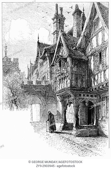 1870: The entrance to the porch of Leicester's Hospital. The Hospital is a historic group of timber-framed buildings in Warwick High Street dating mainly from...