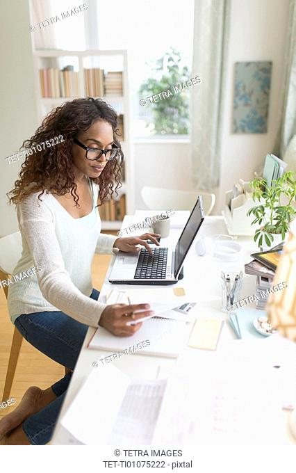Woman paying bills via internet